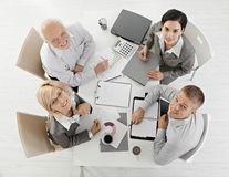 Smiling businesspeople at meeting Stock Photos