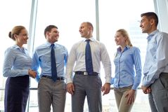 Smiling businesspeople meeting in office Stock Image