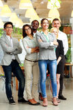 Smiling businesspeople standing together Stock Images