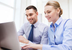 Smiling businesspeople with tablet pc in office Royalty Free Stock Photos