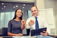 Smiling businesspeople with tablet pc in office Royalty Free Stock Image