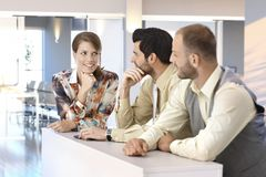 Smiling businesspeople talking at office Royalty Free Stock Image