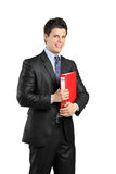 Smiling businessperson. A smiling businessperson holding a red folder with documents isolated against white background Stock Image