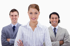 Smiling businessteam with arms folded Stock Photo
