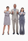 Smiling businessteam giving thumbs up Stock Photos