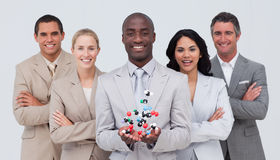 Smiling businessteam holding molecules Stock Images