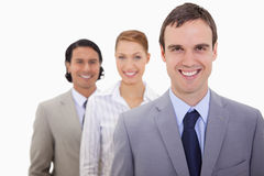 Smiling businessteam lined up Royalty Free Stock Images