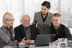 Smiling businessteam on meeting Stock Photography