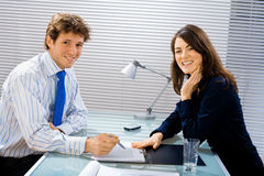 Smiling businessteam at office Stock Images