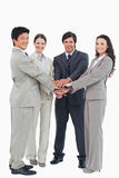 Smiling businessteam putting their hands together Royalty Free Stock Images