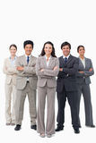 Smiling businessteam standing with arms folded Royalty Free Stock Images