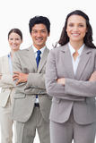 Smiling businessteam standing with folded arms Royalty Free Stock Images