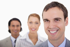 Smiling businessteam standing in a row Stock Image