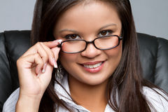 Smiling Businesswoman. Smiling asian businesswoman wearing glasses Royalty Free Stock Images