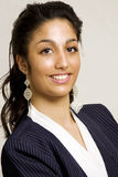 Smiling businesswoman. Beautiful smiling south-asian businesswoman, vertical portrait Stock Photos