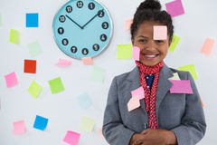 smiling businesswoman with adhesive notes stuck on suit and head Stock Images