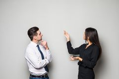 Free Smiling Businesswoman And Businessman Are Conversing Against Grey Background. Royalty Free Stock Images - 102227709