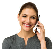 Smiling Businesswoman Answering Smart Phone Stock Photo