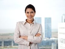 Smiling Businesswoman With Arms Crossed Stock Images