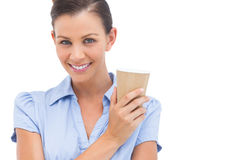 Smiling businesswoman with arms crossed and coffee cup Royalty Free Stock Image