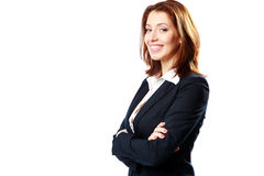 Smiling businesswoman with arms folded Stock Images