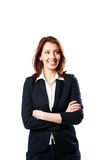 Smiling businesswoman with arms folded looking away Royalty Free Stock Image
