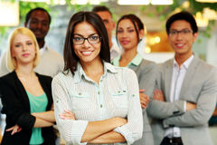 Smiling businesswoman with arms folded Stock Photography