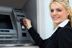 Smiling businesswoman at the ATM Royalty Free Stock Photos