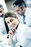 Smiling businesswoman attending meeting Stock Photo