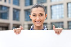 Smiling businesswoman with banner Royalty Free Stock Photo