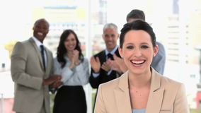 Smiling businesswoman being acclaimed Stock Image