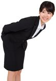 Smiling businesswoman bending Stock Image