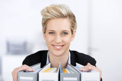 Smiling Businesswoman With Binders Stock Photos