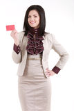 Smiling businesswoman with a blank business badge isolated on wh. Ite Stock Photos