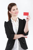 Smiling businesswoman with a blank business badge isolated on wh. Ite Royalty Free Stock Images