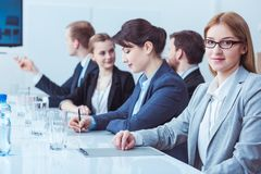 Smiling businesswoman during board meeting royalty free stock images