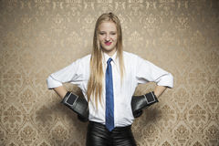 Smiling businesswoman with boxing gloves Stock Image