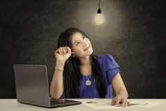 Smiling businesswoman and bright lamp Stock Images