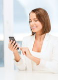 Smiling businesswoman browsing in smartphone Stock Photography