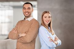 Smiling businesswoman and businessman at office Royalty Free Stock Photography