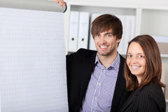 Smiling Businesswoman And Businessman In Office Stock Photo