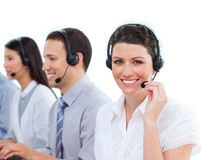 Smiling businesswoman in a call center with her mu Royalty Free Stock Photos