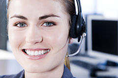 Smiling businesswoman in a call centre Royalty Free Stock Image