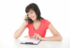 Smiling businesswoman calling by phone Royalty Free Stock Photography