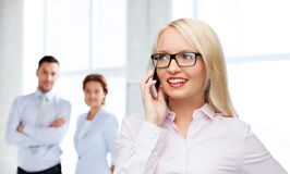 Smiling businesswoman calling on smartphone Stock Photos