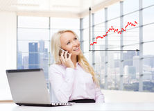 Smiling businesswoman calling on smartphone Stock Image