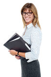 Smiling businesswoman carrying important files Stock Photography