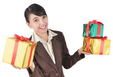 Smiling businesswoman carrying pile of gifts. Isolated on white background Stock Photo
