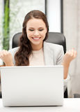 Smiling businesswoman celebrating victory or win Royalty Free Stock Photo