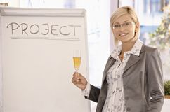 Smiling businesswoman with champagne Royalty Free Stock Image
